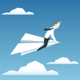 Businessman is  flying on paper airplane and  looking forward Royalty Free Stock Photo