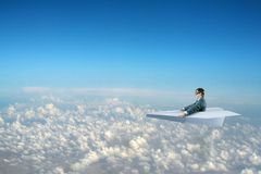 Businessman flying on paper plane Royalty Free Stock Photography