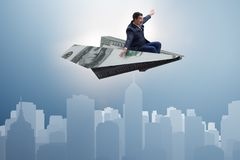 The businessman flying on paper plane in business concept Royalty Free Stock Photo