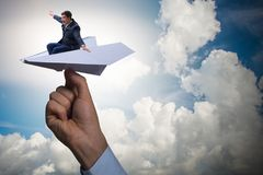 The businessman flying on paper plane in business concept Stock Photography