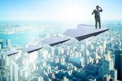 The businessman flying on paper plane in business concept Royalty Free Stock Photography