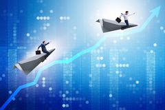 The businessman flying on paper plane in business concept Royalty Free Stock Image