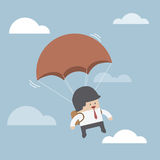 Businessman is flying with parachute Royalty Free Stock Photos
