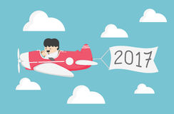 Businessman flying a plane .Concept of New Year 2017 Royalty Free Stock Images