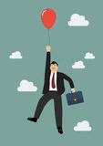 Businessman flying with red balloon Stock Photography