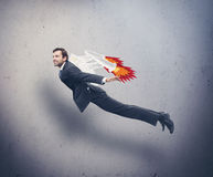 Businessman flying with rocket backpack Stock Image