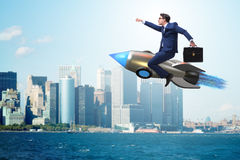 The businessman flying on rocket in business concept Royalty Free Stock Images