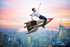 The businessman flying on rocket in business concept Stock Photos