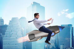 The businessman flying on rocket in business concept Stock Photo