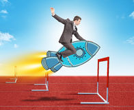 Businessman flying on rocket Royalty Free Stock Photo