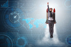 The businessman flying with rocket in funny business concept Stock Photography