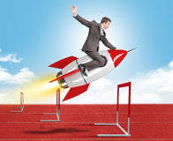 Businessman flying on rocket. Businessman flying on red rocket above treadmill barriers Royalty Free Stock Photography