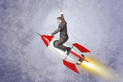 Businessman flying on rocket Royalty Free Stock Image