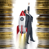 Businessman flying on rocket Stock Image