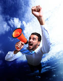 Businessman flying and shouting through. Megaphone Stock Image