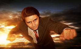 Businessman flying at sky sunset. Background Royalty Free Stock Photo