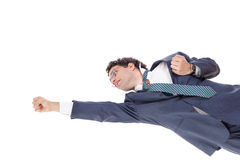 Businessman flying in the style of Superman Stock Images