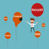 Businessman flying success balloon and  pushing needle to pop a problem balloons. Stock Photography