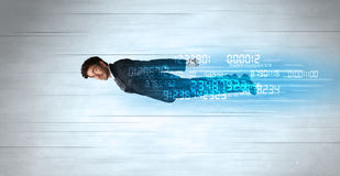 Businessman flying super fast with data numbers left behind Stock Photos