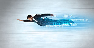 Businessman flying super fast with data numbers left behind Stock Image