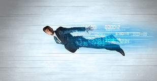 Businessman flying super fast with data numbers left behind. Concept royalty free stock photos