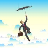 Businessman flying on Umbrella Royalty Free Stock Photo