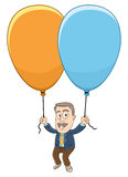 Businessman - Flying up with balloon Royalty Free Stock Image