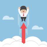 Businessman flying up through the clouds with growth arrow Royalty Free Stock Photo