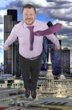 Businessman flying up with modern city in Royalty Free Stock Photos