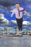 Businessman flying up with Tower bridge, London Royalty Free Stock Photography
