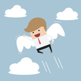 Businessman flying with wings Stock Photography
