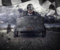 Businessman flying with a wooden toy plane. Businessman in a suit flying with a wooden toy plane stock image