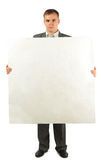 Businessman with foam plastic board for text Stock Image