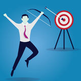 Businessman focus to hit target with bow and arrow Stock Image