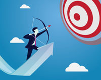 Businessman focus to hit target with bow and arrow Royalty Free Stock Photography