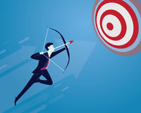 Businessman focus to hit target with bow and arrow Stock Photography