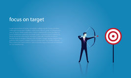 Businessman focus to hit target with bow and arrow Royalty Free Stock Image