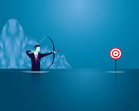 Businessman focus to hit target with bow and arrow Stock Images
