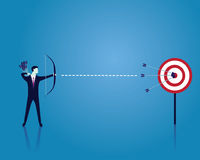 Businessman focus to hit target with bow and arrow Royalty Free Stock Photo