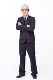 Businessman with folded arms. Standing attractive businessman with folded arms against white Royalty Free Stock Photo