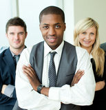 Businessman with folded arms with his colleagues Royalty Free Stock Images