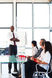 Businessman with folded arms  in a meeting Stock Images