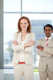 Businessman with folded arms standing Stock Image