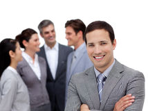 Businessman with folded arms standing with Stock Images