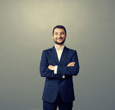 Businessman with folded hands over dark Royalty Free Stock Photography