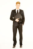 Businessman with folder Stock Images