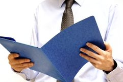 Businessman with folder. Man in shirt and tie with an open folder in hands Royalty Free Stock Photo