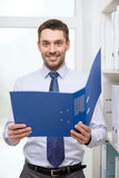 Businessman with folder at office Stock Photos
