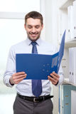Businessman with folder at office Royalty Free Stock Image
