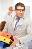 Businessman with folders in office Royalty Free Stock Photography